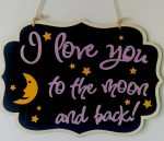 black wooden sign with qoute: I love you to the moon and back