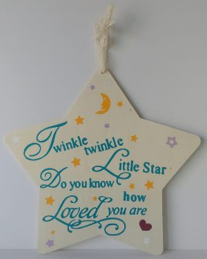 star shaped wooden sign with nursery rhyme